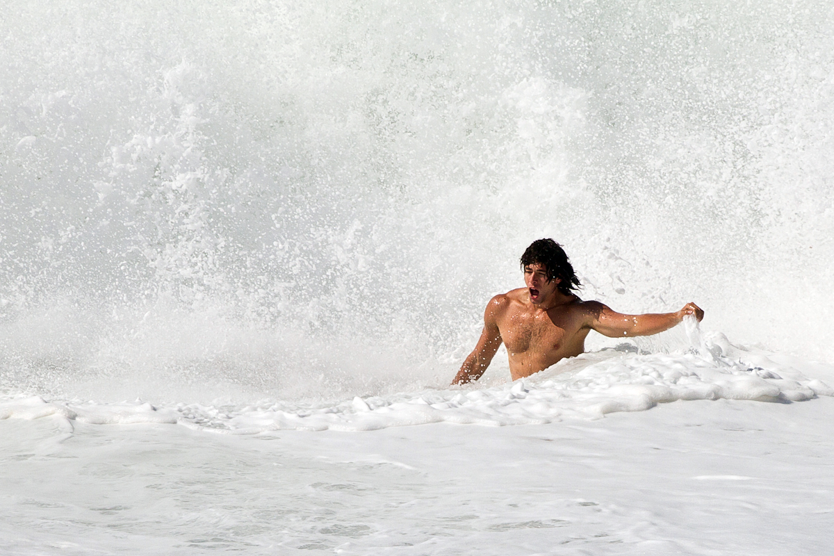Crashing-waves-Bolivian-athlete-Rolo-Ismael-in-a-short-swim-Sicily-Italy-July-2011