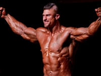 Front-Double-Bicep-pose-Swiss-Bodybuilding-Champion-Christophe-Colliard-WABBA-Suisse-2011-Epalinges-Switzerland-May-2011