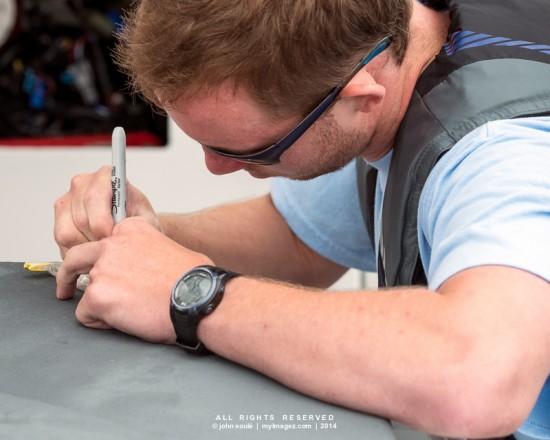 Member of National Aquarium Team records GPS location of water samples